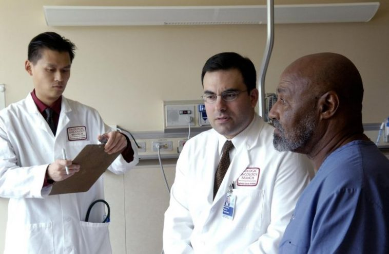 Doctor_consults_with_patient_1-795x518