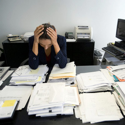 woman-stressed-at-work-skin-agers-dg-pg-full
