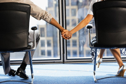 Businesspeople Holding Hands --- Image by © Smart Creatives/Corbis