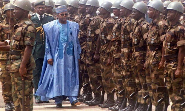 Nigerian President Sani Abacha arrives at the airport in Freetown, Sierra Leone for a ceremony marking the return of Sierra Leone's ousted President Ahmed Tejan Kabbah Tuesday March 10, 1998. A Nigerian-led peacekeeping force drove Sierra Leone's military junta from the country allowing Kabbah to return after ten months in exile.  Abacha, widely criticized for alleged human-rights abuses at home, has been welcomed as a hero in Sierra Leone. (AP Photo/James Fasuekoi)