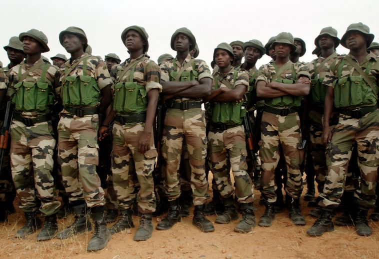 070403-N-6901L-011 Maradi, Niger (April 3, 2007) - Nigerian soldiers from the 322nd Parachute Regiment line up in formation before participating in target practice facilitated by U.S. Army soldiers during Operation Flintlock 2007. The primary focus of Operation Flintlock is to provide an interactive exchange of military, linguistic and intercultural skills for both nations. U.S. Special Operations Forces depend on the ability to interface with foreign military forces in which this training is meant to enhance. The training will also help Niger to respond to threats within and across their borders to maintain security and stability. This event is part of an ongoing and long standing military-to-military relationship that the U.S. enjoys with Niger, and part of the U.S. State Department's Trans-Sahara Counterterrorism Partnership (TSCTP). U.S. Navy photo by Mass Communication Specialist 1st Class Michael Larson. (RELEASED)