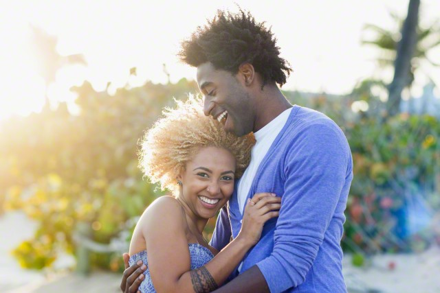 Young smiling couple embracing --- Image by © Kevin Dodge/Corbis