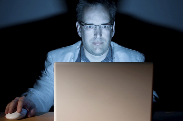 Man working late in front of his computer