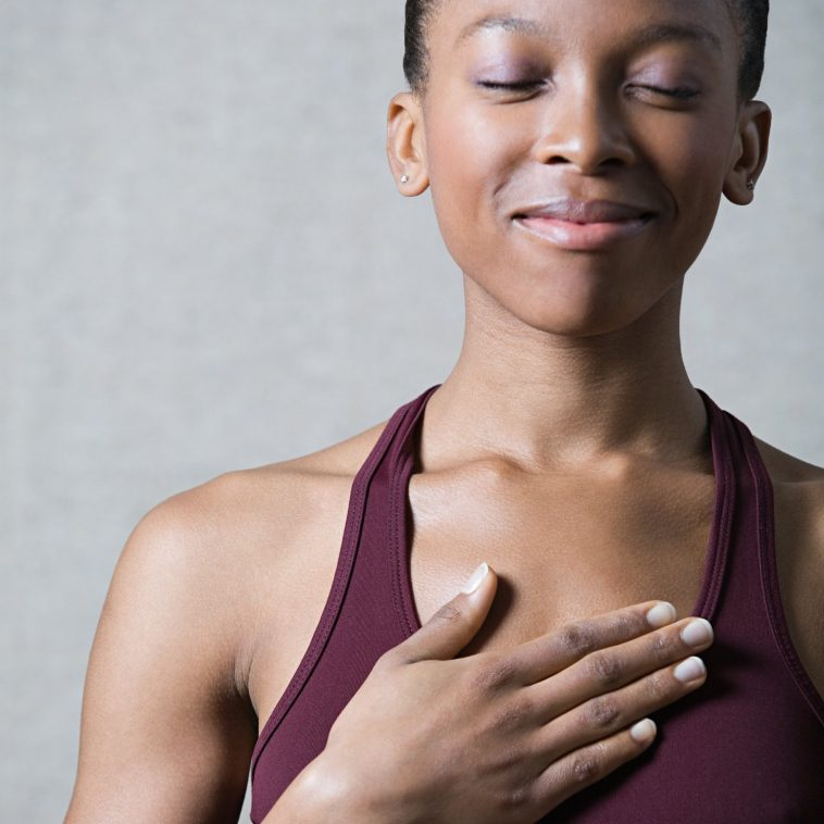 woman-with-hand-on-chest_0