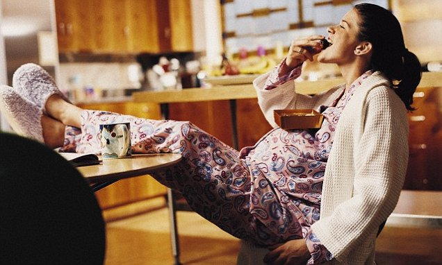 Pregnant Woman Eating Chocolate --- Image by © 2/Cohen/Ostrow/Ocean/Corbis