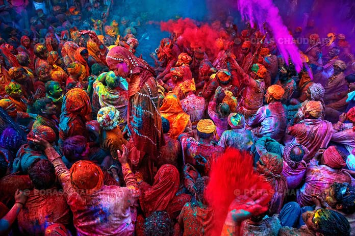The festival of Holi is a religious festival. People sing bhajans of Radha and Lord Krishna on this day and it marks the beginning of Spring Season in india.Here you can see a gathering of people singing folk songs and dancing while people throwing colors on them during Holi (Festival of Colors), India…