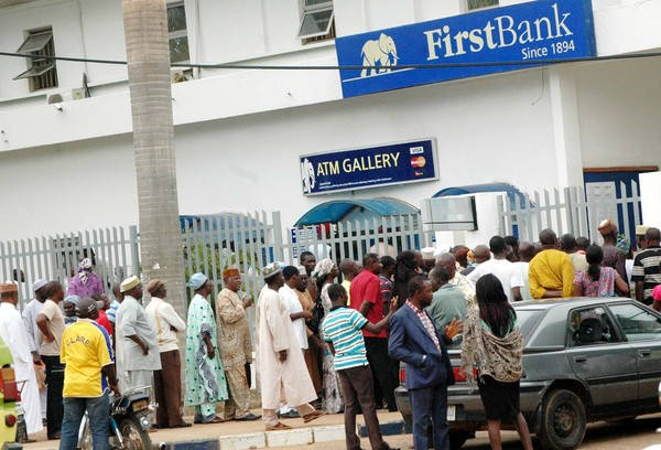 PIC.1.CUSTOMERS QUEUE  AT A BANK  ON YAKUBU GOWON WAY, KADUNA, DURING THE TIME OF 24HOUR CURFEW RELAXATION   ON TUESDAY (26/6/12).