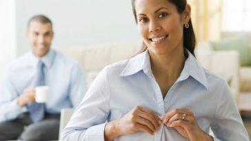 woman buttoning shirt