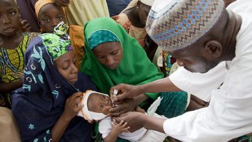 NIGERIA / Kano / 4 June 2010 Children receive Oral Polio Vaccine during the official flag-off of the polio campaign of the Gwale LGA at Tudunyola in the Kabuga locality of Kano city.