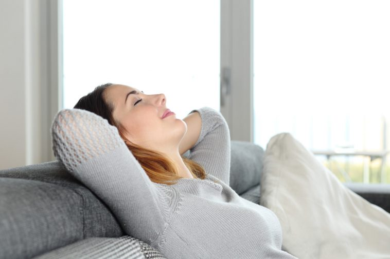 Happy Relaxed Woman Resting On A Couch At Home image source: www.hohchiro.ne
