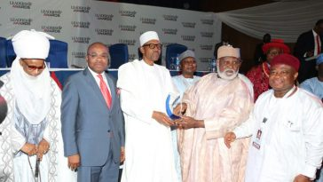 PRESIDENT BUHARI RECEIVES LEADERSHIP AWARD 1B. R-L; Former Head of State, General Abdusalami Abubakar presenting 2015 Leadership Newspaper Man of the Year Award to President Muhammadu Buhari. With him are Akwa Ibom State Governor, Mr Udom Emmanuel, Chairman Leadership Newspaper Group, Mr Sam Nda-Isaiah and Estu Nupe, HRH Alhaji Yahaya Abubakar held at the Transcorp Hilton Hotel in Abuja. PHOTO; SUNDAY AGHAEZE. OCT 6 2016