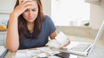Brunette looking worried over bills