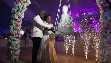 couple-cutting-their-cake