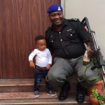 Tonto-Dikehs-son-poses-with-policeman