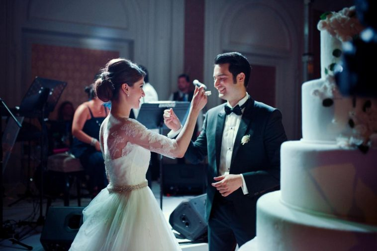 couple feeding each other with cake